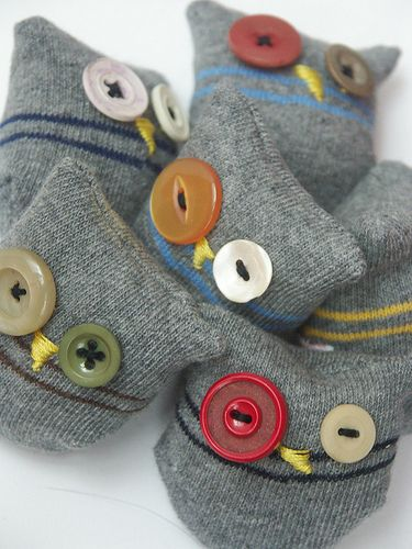 I love searching for then actually finding things to do with the stuff that I am tempted to recycle or trash.  Sock owls (and others!).