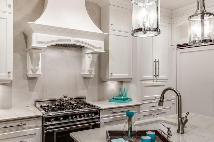 Classic kitchen style with maple cabinet painted in white lacquer.