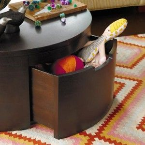 Kid-friendly living room storage in large coffee table drawers