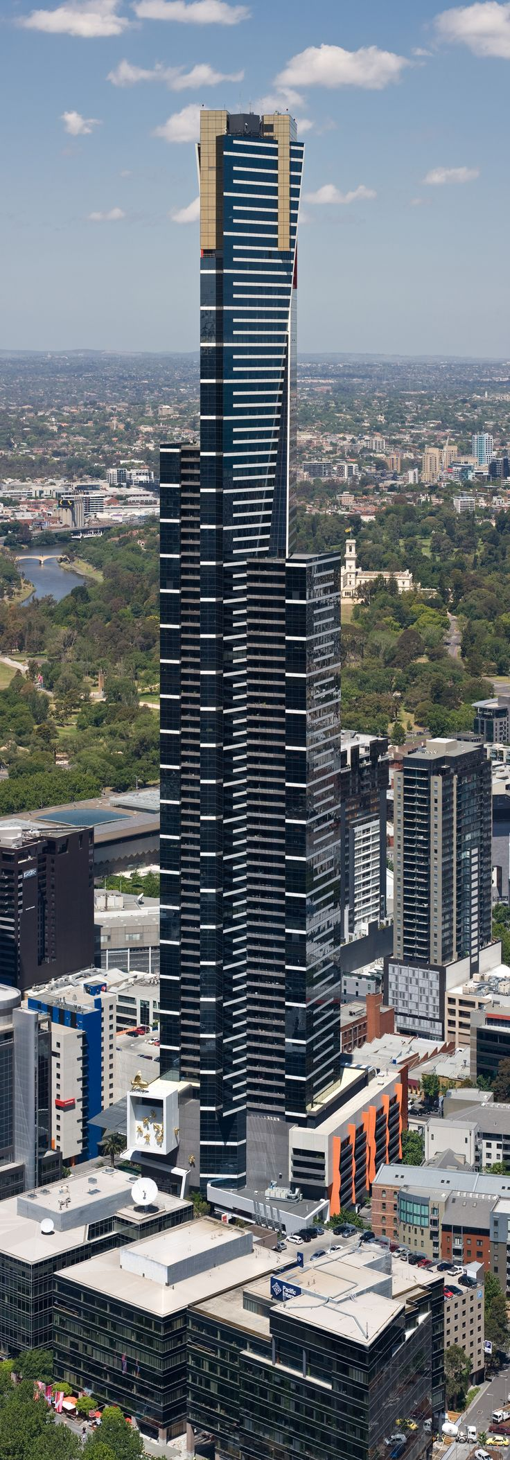 Eureka Tower is a 297.3-metre (975 ft) skyscraper located in Melbourne, Victoria, Australia. It is named after the Eureka Stockade, a rebellion during the Victorian gold rush in 1854. This has been incorporated into the design, with the building's gold crown representing the gold rush and a red stripe representing the blood spilt during the revolt. It was the world's tallest residential tower now 12th. (Click to see Botanical Gardens Government House immediate background)