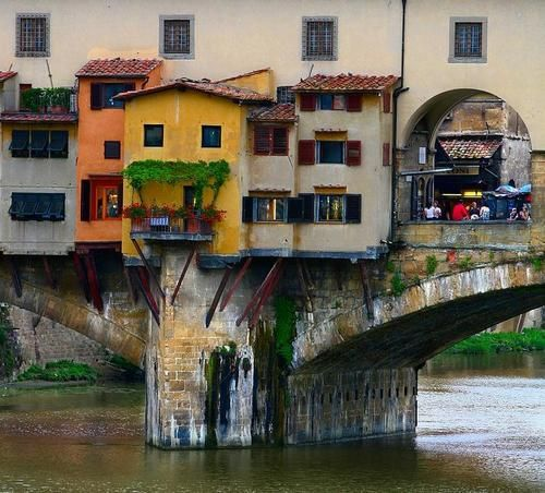 """The Ponte Vecchio (""""Old Bridge"""") is a Medieval stone closed-spandrel segmental arch bridge over the Arno River, in Florence, Italy, noted for still having shops built along it, as was once common. ..."""