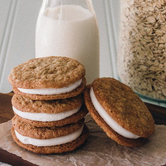 A knock off recipe for Little Debbie oatmeal creme pies featuring gluten free oatmeal cookies sandwiched with homemade marshmallow filling