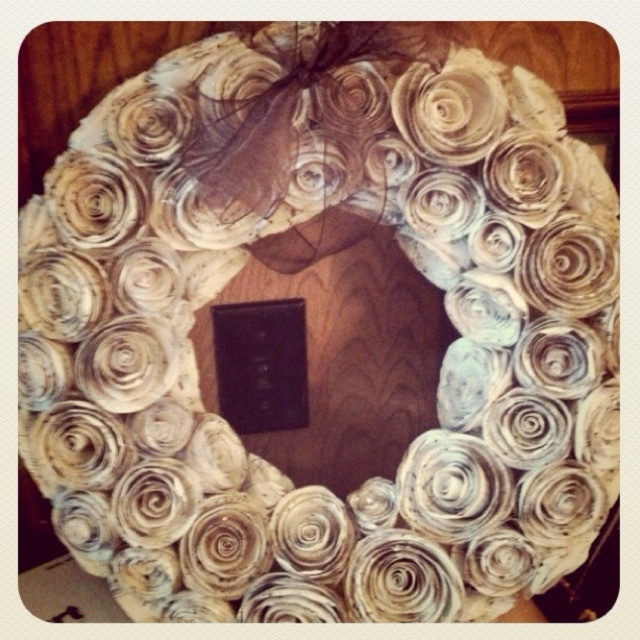 flower wreath I made out of vintage sheet music for my friend's wedding gift.