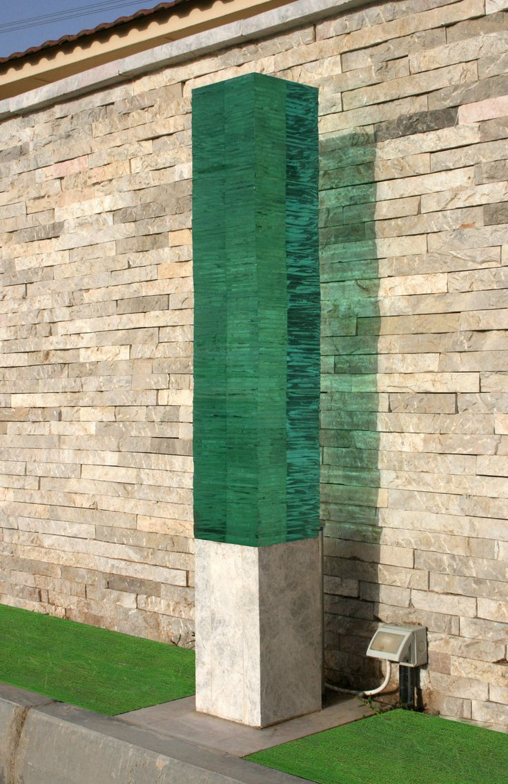 Water COLUMN :  Stone (from RAK) and Glass outdoor Lighting designed and made by Amedee Santalo.