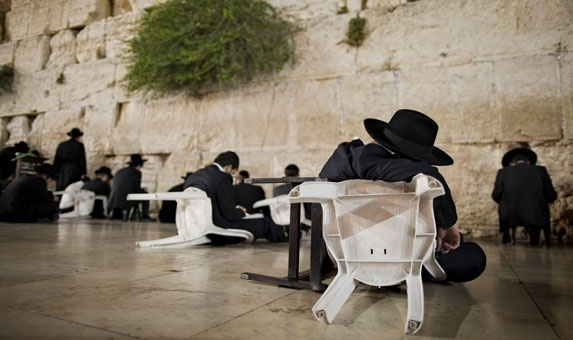 7/29/2012  Ultra-Orthodox Jewish men pray during the mourning ritual of Tisha B'Av at the Western Wall in Jerusalem's Old City. Tisha B'Av is when Jews mourn the destruction of Biblical temples.