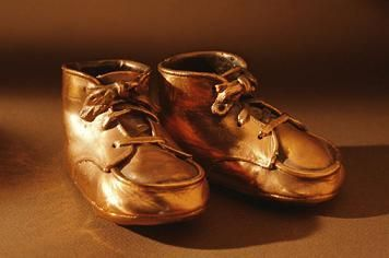 It was a big thing to bronze your baby's first walking shoes ~ I never did get around to it !