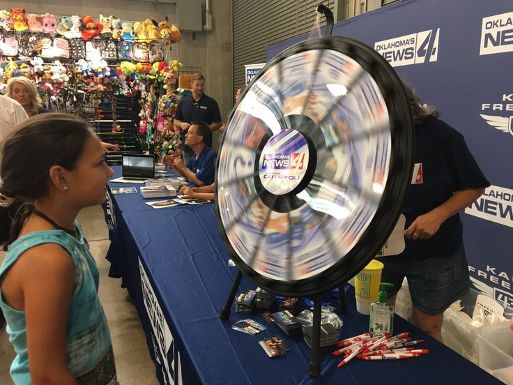 The smell of corn dogs, cotton candy and barbeque filled the air at the Oklahoma State Fair. Thousands of visitors flocked to take in the sights, sounds and smells of this exciting annual event. Read more about the Prize Wheel at https://PrizeWheel.com/blog/.