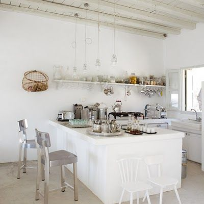 Dutch Elle living magazine showed the summer house of Italian designer and architect Paola Navone on the Greek Island Serifos #white #kitchen #interiors