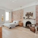 Bright Faux Brick Panels look New York Scandinavian Bedroom Image Ideas with arched fireplace art above fireplace baroque minimalism brick wall ceiling detail ceiling medallion crown