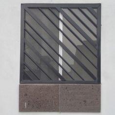 Imagen de diseño de verjas de fierro inclinadas de ventana contemporánea residencial