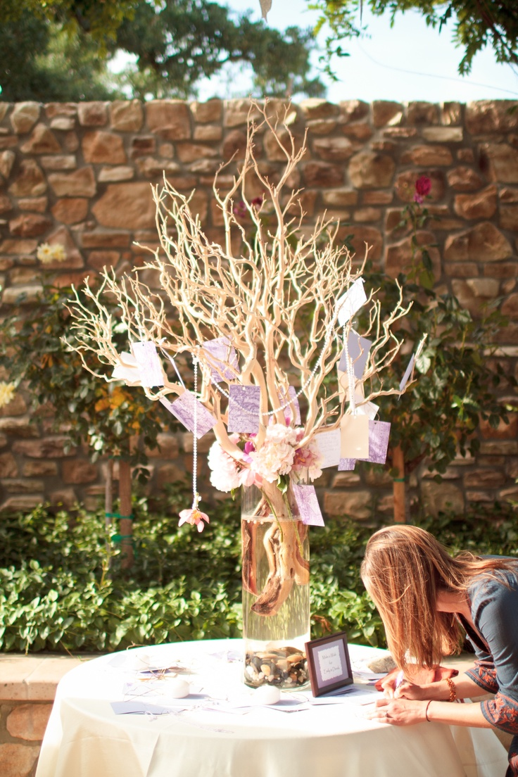 Our wishing tree.- guest book, guests write their well wishes on a tab and put it on the wishing tree