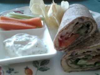 Hummus Wrap @ Sunflower Organic Cafe.  It was delish & really garlicky.  Served with chips and veggies w/ dip.  $ 6.95 plus tax
