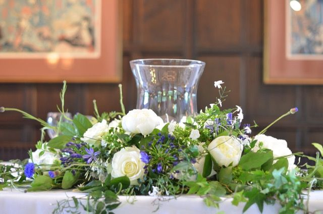 Top Table arrangement at Ramster Hall by Spriggs Florist