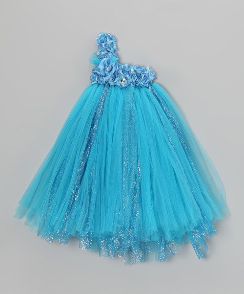 Perfect for little twirlers, this vibrantly hued frock touts two layers of tulle and matching lining, so it's always soft, never itchy. A stretchy bodice keeps it securely in place, while silky flowers and cascades of glitter finish off this fluffy waterfall of fabulousness!