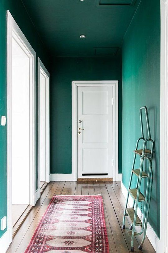 This bold emerald green hallway looks so fresh with bright white trim and a happy pink vintage runner!