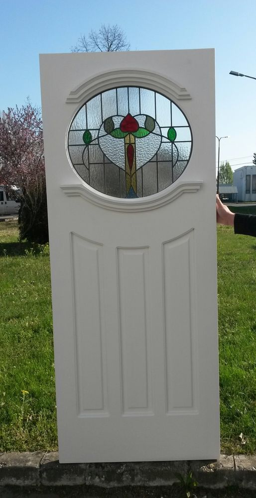 1930 s Oval front door with stained glass.