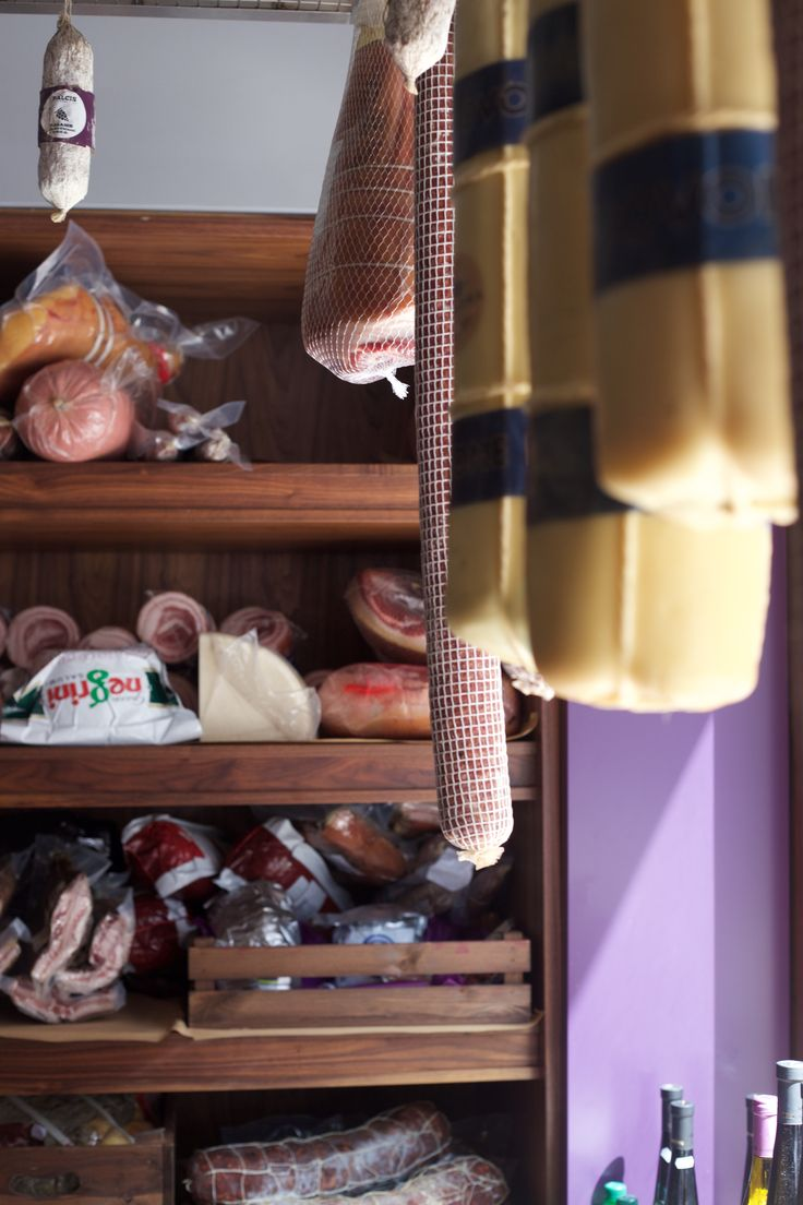 Hanging cheese and charcuterie in our refrigerated cave