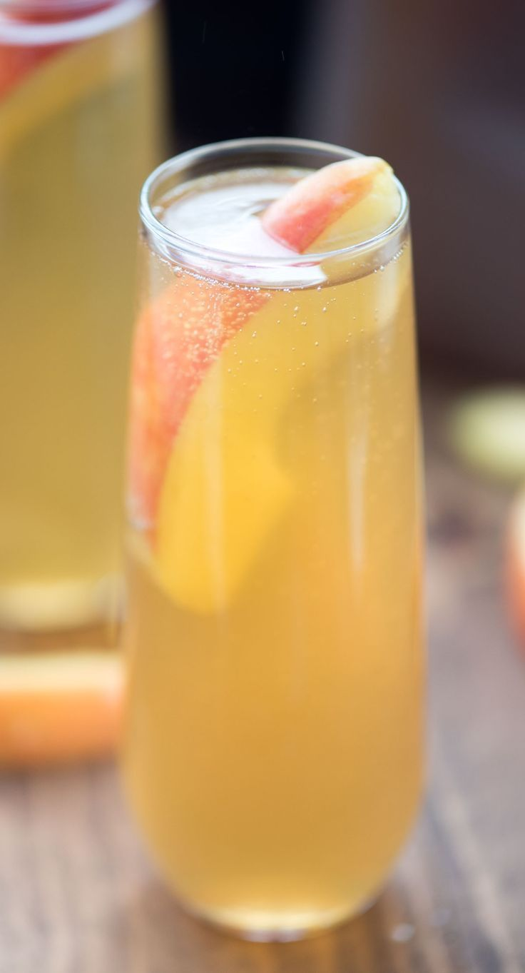 This Apple Cider Bellini is the perfect fall cocktail recipe! It's easy with only three ingredients and is perfect for your Thanksgiving menu.