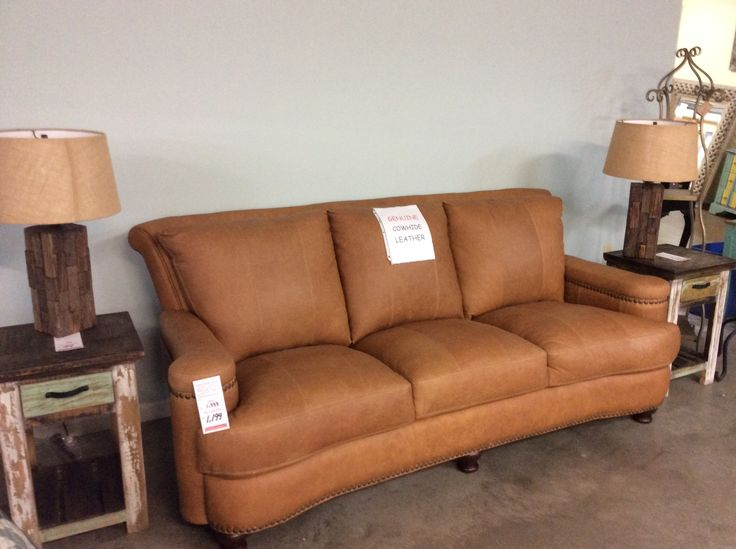 """The Leather Italian """"Hutton"""" sofa looks great paired with these Rustic Canyon end tables & Rustic Ashley lamps.  Sofa ( genuine cowhide all over leather) $1199 end table $99 lamp $155"""