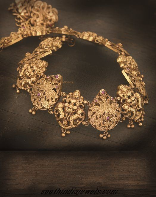 Elegant Antique temple jewellery necklace from Navarathan jewellers. Goddess embossed motifs clasped together to form a antique finish necklace.