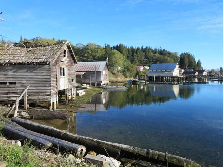 Old boathouses line the shore of Rough Bay at Sointula on Malcolm Island, British Columbia, Canada.