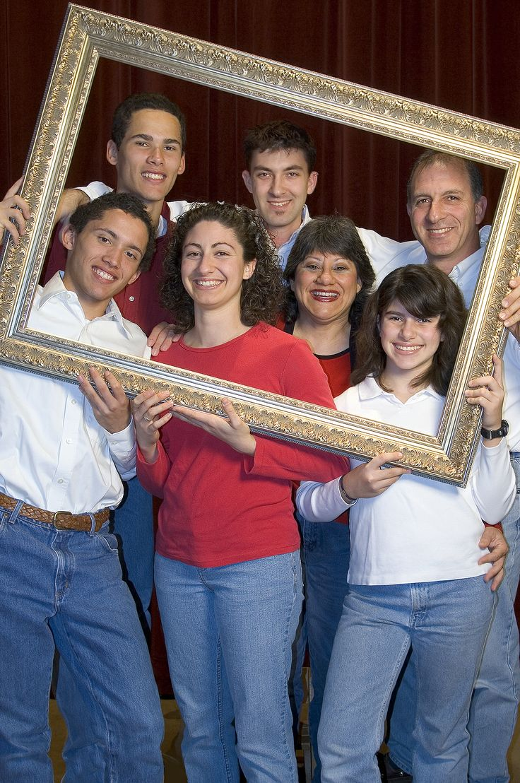 Economides Family self portrait. Frame from Michaels, camera on a tripod and self timer. Shot at Scottsdale Bible Church on their platform with a maroon curtain as the background.