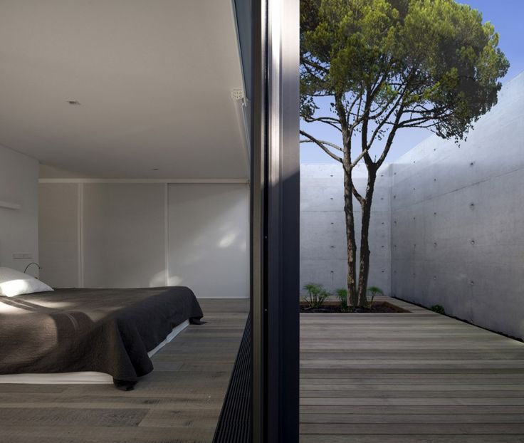 This sleek home is located on a sandy site in Comporta, Portugal. Designed by RRJ Arquitectos, this structure meets the needs of living in a harsh environment. Sun protection is a main concern in the scheme of House in Comporta. The single story home sits low on the site, maximizing coolness and minimizing sun exposure. The thick, concrete walls guard the home from the sun at the most vulnerable points. All the windows are recessed in the facade for extra shade during the brightest parts of…