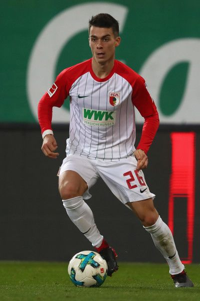 Erik Thommy of Augsburg runs with the ball during the Bundesliga match between FC Augsburg and VfL Wolfsburg at WWK-Arena on November 25, 2017 in Augsburg, Germany.