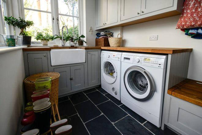 Butler's pantry:  Wooden countertops, sink, cabinets below sink