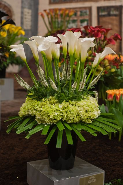 Calla lily and green hydrangea reception wedding flowers