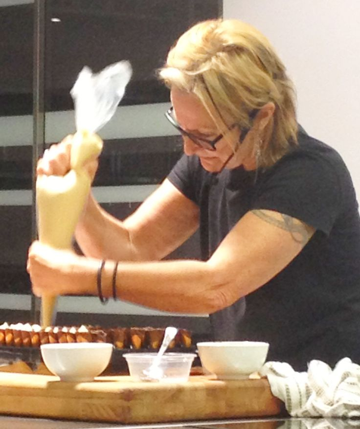 """Chocolatier extraordinaire"" Christine Manfield at work making miniature Dulcey blonde chocolate (white chocolate with a slight caramel flavour) mousse waffle cones with dark chocolate pearls."