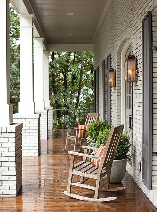 Perfectly aligned rows of wall sconces and square columns frame this covered porch beautifully.