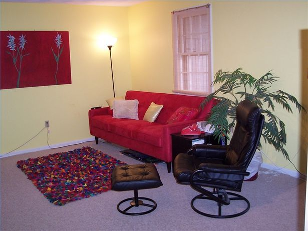 decorating with a red sofa red couch decorating ideas thumbnail