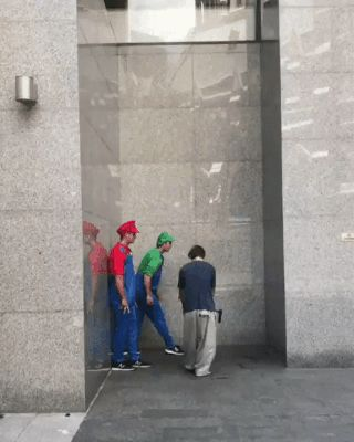 GIF Guys in Mario costumes who can climb walls – TAP