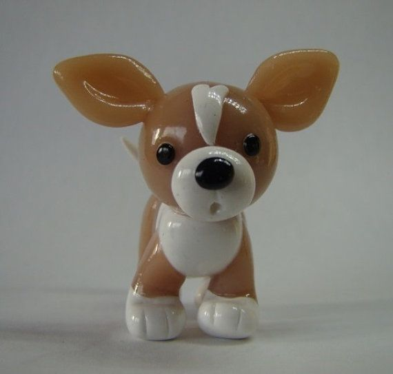 "Adorable little Chihuahua puppy wants a forever home with you. He will surely bring a smile to your face and light up your day. Keep him at your desk and he'll be perfectly content to keep you company.  Puppy is approximately 1.5"" tall and 1.5"" long, and is made entirely of polymer clay. He is then carefully hand-glossed for extra durability. This item is made to order! Please allow 3 – 5 business days for your item to be made.  Due to the handmade nature of this item, each puppy is unique…"