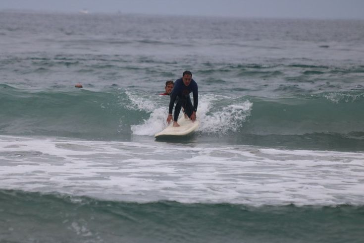 Learn to surf with San Diego Surf School. We offer private surf lessons, semi-private lessons , SUP lessons, kids surf camps and group surfing lessons.