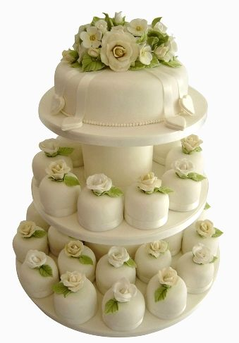 Tower of mini cakes decorated with roses and wild flowers made from sugar Aline