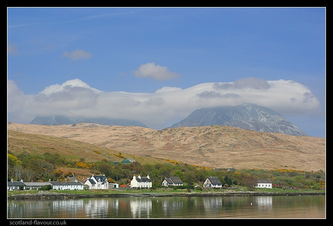 Photograph of the Paps of Jura rising behind the village of Craighouse, Isle of Jura.