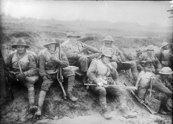 BATTLE SOMME 1 JULY - 18 NOVEMBER 1916 (E(AUS) 19) Eight ANZAC (Australian and New Zealand Army Corps ) soldiers wearing sheepskin jackets, and a mixture of slouch hats and steel helmets, resting on their way up to the trenches.