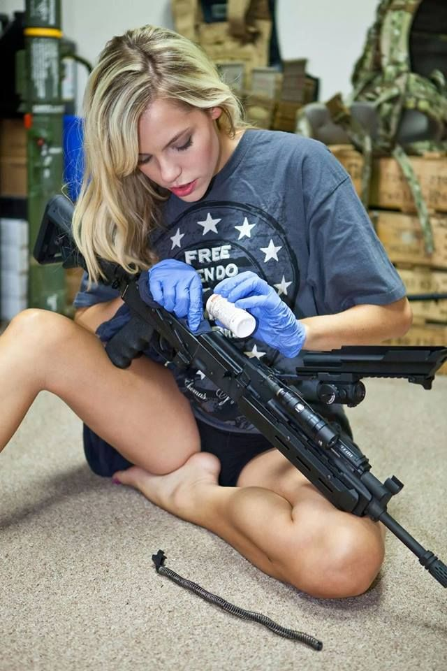 Nude girls with handguns