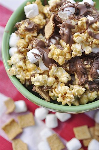 Smores Popcorn  1 batch of caramel corn (already pinned)    2-3 C of miniature marshmallows    2-3 C of Golden Graham cereal    1 pkg. of chocolate chips (I used milk chocolate)    Spread caramel corn onto two parchment lined cookie sheets to cool.  Sprinkle with marshmallows and cereal.  Melt chocolate chips and then drizzle chocolate over mixture.  Allow chocolate to set up.  Enjoy!