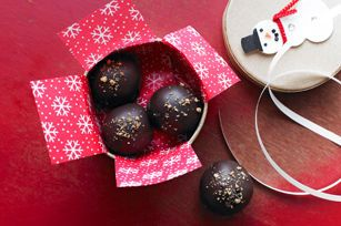 Chocolate chip cookies and cream cheese give these semi-sweet chocolate-dipped cookie balls their sweet and subtle scrumptiousness.  These Chocolate Chip Cookie Balls are a sweet treat - perfect for holiday gift-giving and cookie exchanges!