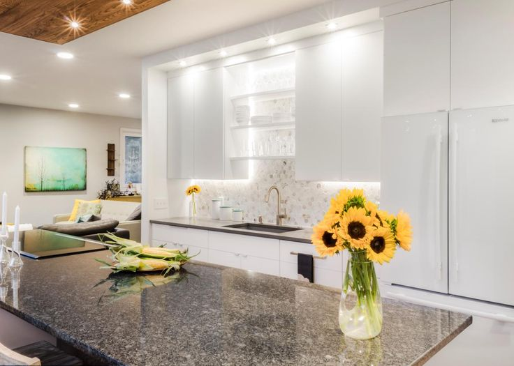 This Light And Bright Kitchen Features Flat Front White Cabinets Paired With A Light Gray Countertop Coverskitchens