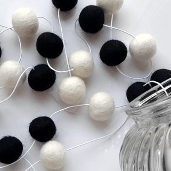 Monochrome black and white wool felt ball garland available at Desa Life. www.desa.life
