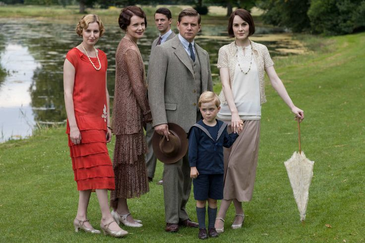 Downton AbbeySeries Finale Airs Sunday, March 6, 2016 on MASTERPIECE on PBS Shown from left to right: Laura Carmichael as Lady Edith, Elizabeth McGovern as Cora, Countess of Grantham, Matthew Goode as Henry Talbot, Allen Leech as Tom Branson, Zac/Oliver Barker as Master George, and Michelle Dockery as Lady Mary (C) Nick Briggs/Carnival Film & Television Limited 2015 for MASTERPIECE This image may be used only in the direct promotion of MASTERPIECE CLASSIC. No other rights are granted. All…