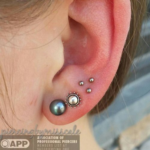 Triple earlobe piercing by APP member Cale Belford at Piercing Emporium in Worcester, MA.
