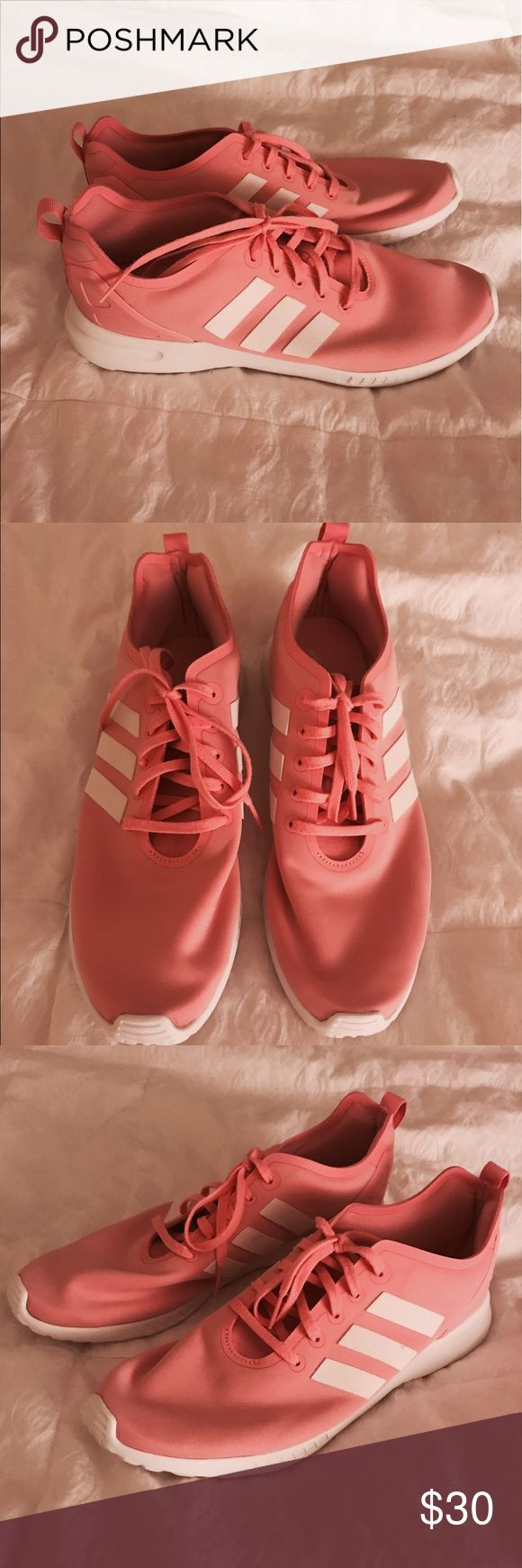 Adidas sneakers Lightweight, comfortable adidas sneakers. Very thin, breathable fabric. No scuffing or fading. The color is a pepto bismol traditional pink. The shoes are in great condition! Adidas Shoes Sneakers