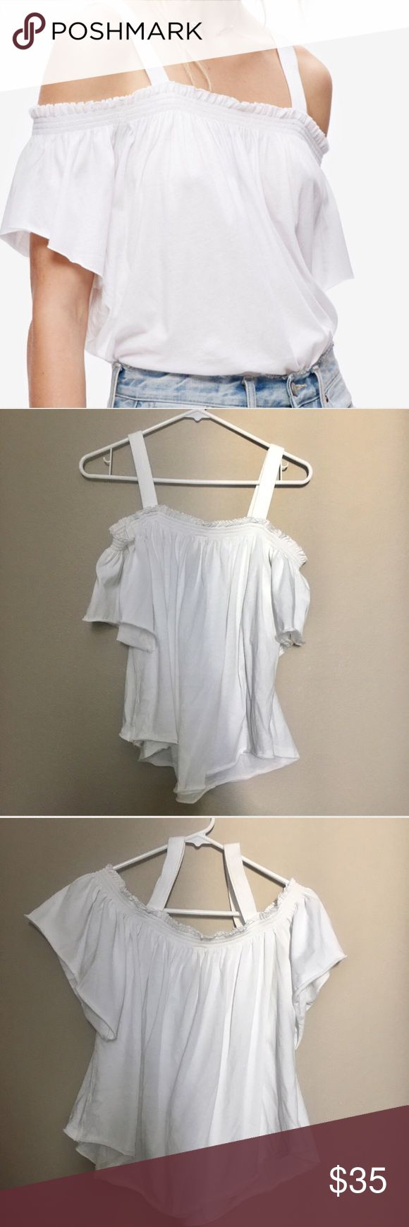 """Free People Cold Shoulder White Top Size Medium Free People Cold Shoulder White Top  •Like new! •Lightweight and comfortable! •Stretchy elastic band around chest and shoulders   •Approximate Measurements: Bust: 34.5"""" Neckline to bottom: 18""""  Ships SAME or NEXT DAY from a SMOKE-FREE environment! Free People Tops Blouses"""