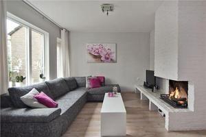 mooi interieur met wit, grijs en roze tinten