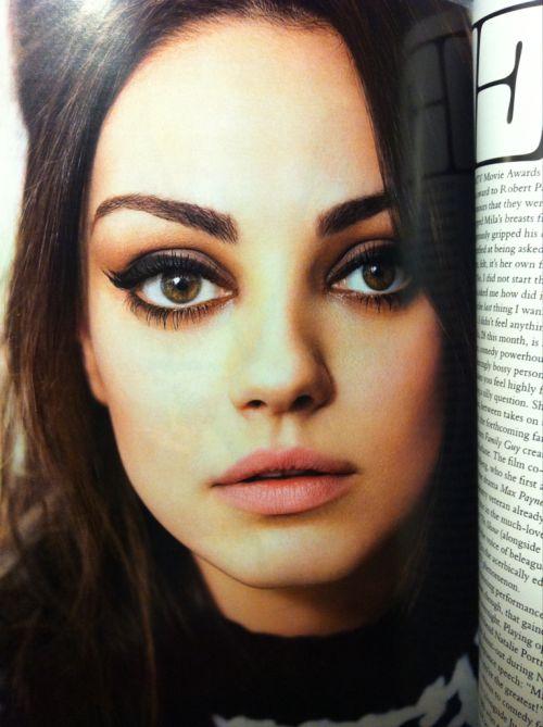 mila kunis' winged liner, purple shadow, brown crease, eyeliner, natural lips.